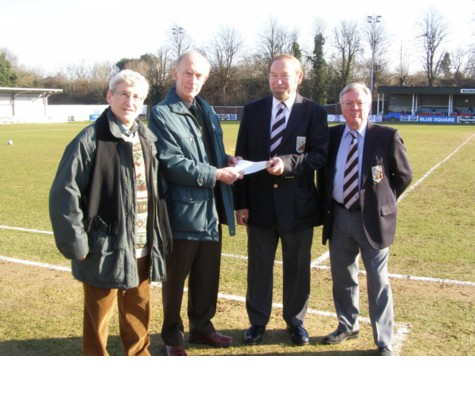 John Foulger accepts a cheque
